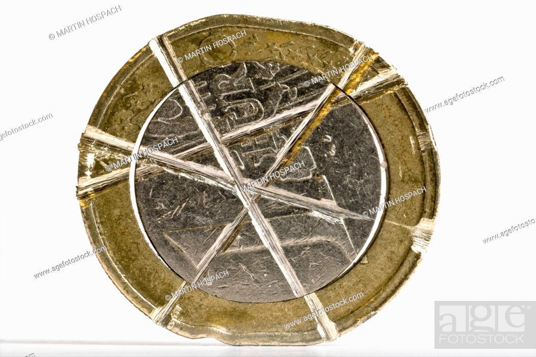 Stock Photo: A one euro coin with crisscrossed dents in it.