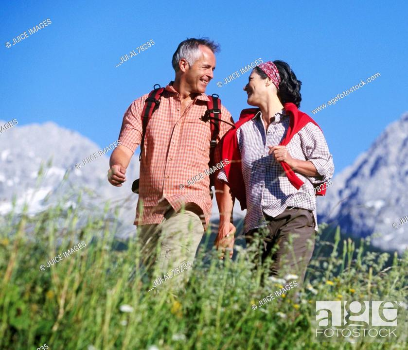 Stock Photo: Couple holding hands in hills in Germany.