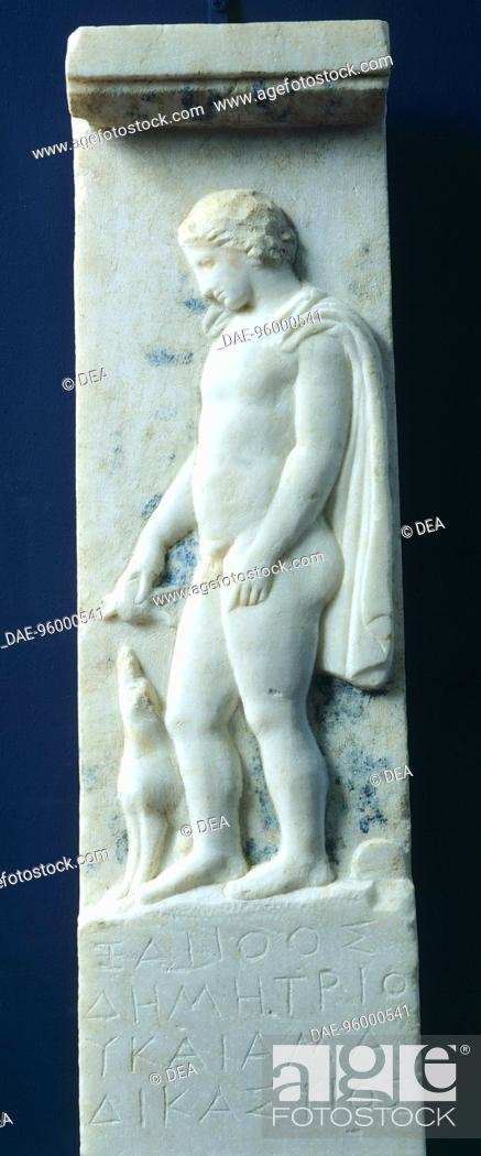 Stock Photo: Marble funerary stele with relief depicting a young deceased man and an inscription, from the cemetery at the Agora' of Pella, Greece.