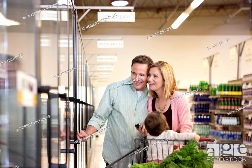 Stock Photo: Family shopping together in supermarket.