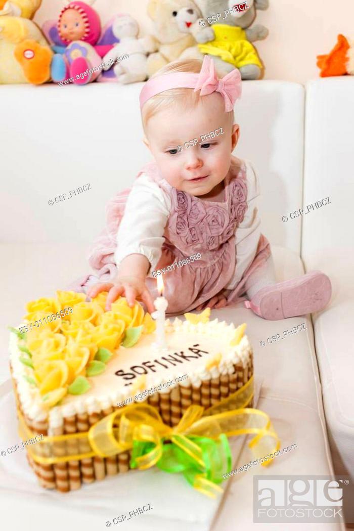 Surprising Portrait Of Sitting Toddler Girl With Her Birthday Cake Stock Personalised Birthday Cards Veneteletsinfo