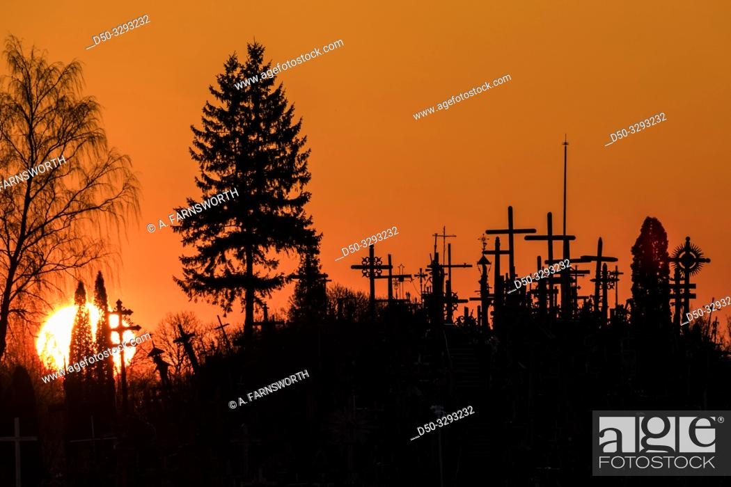 Stock Photo: Siauliai, Lithuania Early morning and dawn view of The Hill of Crosses, or, KryžiŠ³ kalnas, a pilgrimage site for Catholics and is a collection of 100.