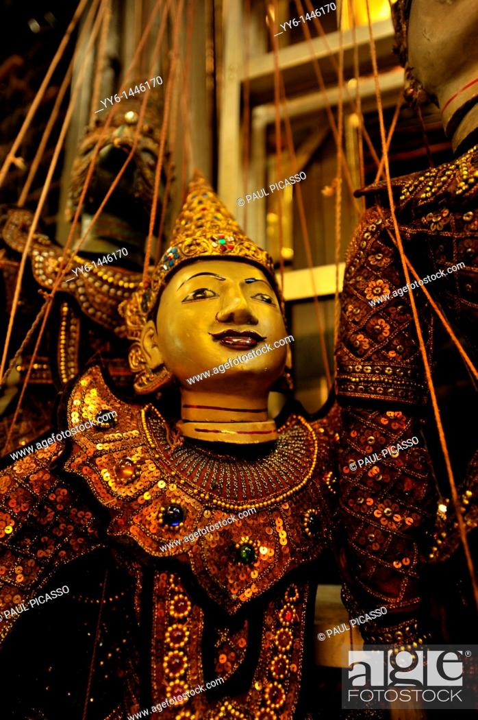 Stock Photo: puppets and the puppet master , Chatuchak weekend market , also known as jatujak , Bangkok, thailand.