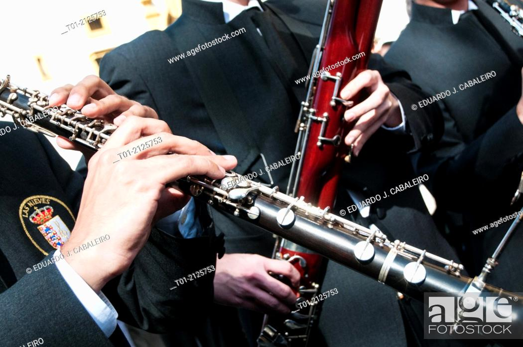 Stock Photo: oboe and bassoon musicians in the Holy Week in Seville.
