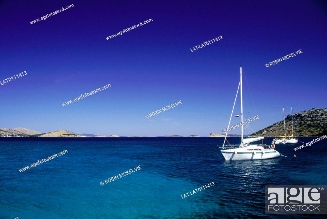 Stock Photo: The Dalamatian coast is a popular destination for yachts cruising in the waters of the Adriatic Sea. there are many sheltered harbours suitable for overnight.