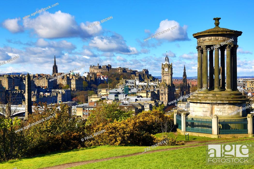 Stock Photo: General city skyline view from Calton Hill showing the Dugald Stewart Monument and Edinburgh Castle in Edinburgh, Scotland, United Kingdom.