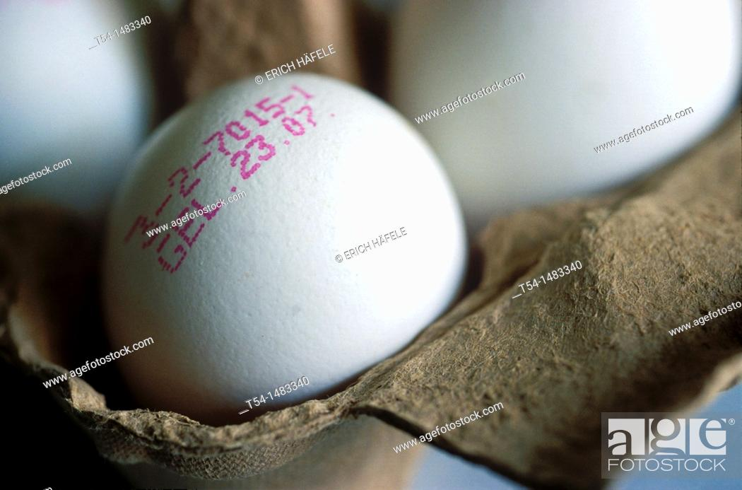 Stock Photo: Egg white with pink-date stamp date of laying eggs in carton.