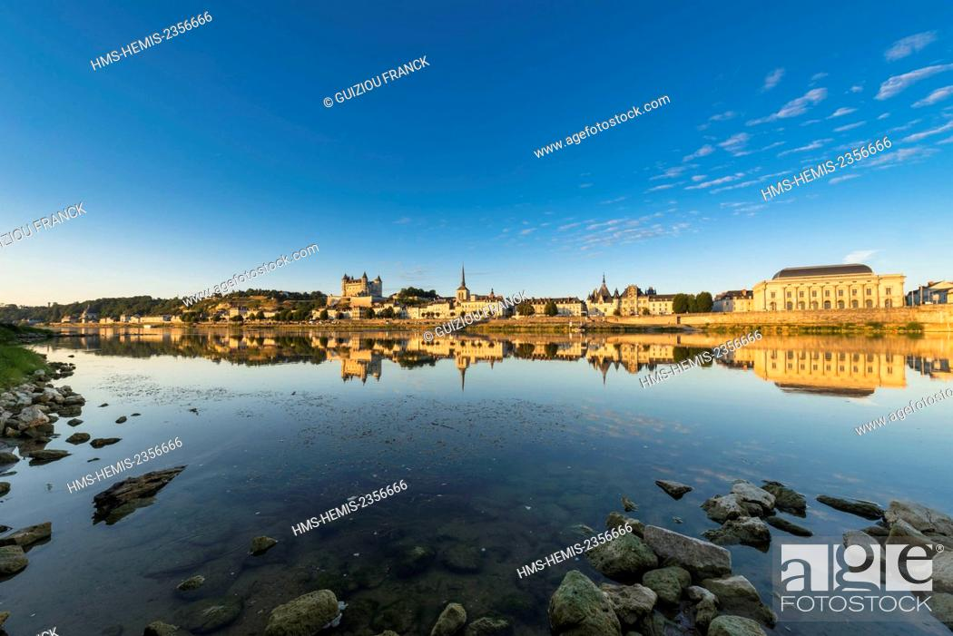Stock Photo: France, Maine et Loire, Loire valley listed as World Heritage by UNESCO, Saumur, the castle, Saint-Pierre church, the town hall and the theatre are reflected in.