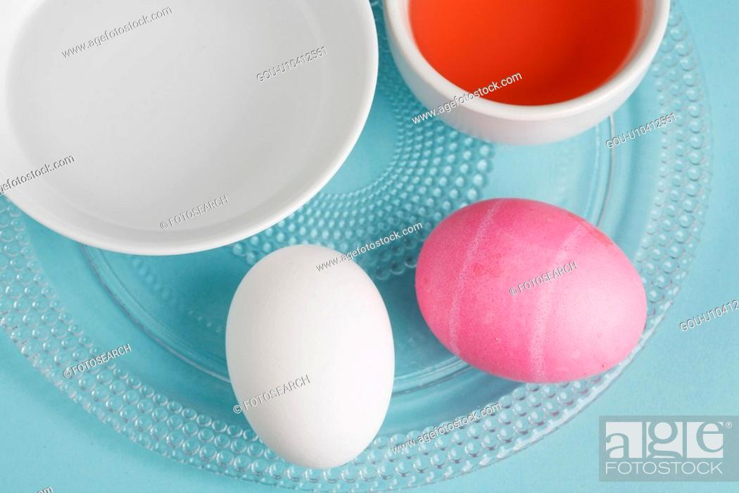 Stock Photo: Two eggs by Easter egg dye (close-up, directly above).