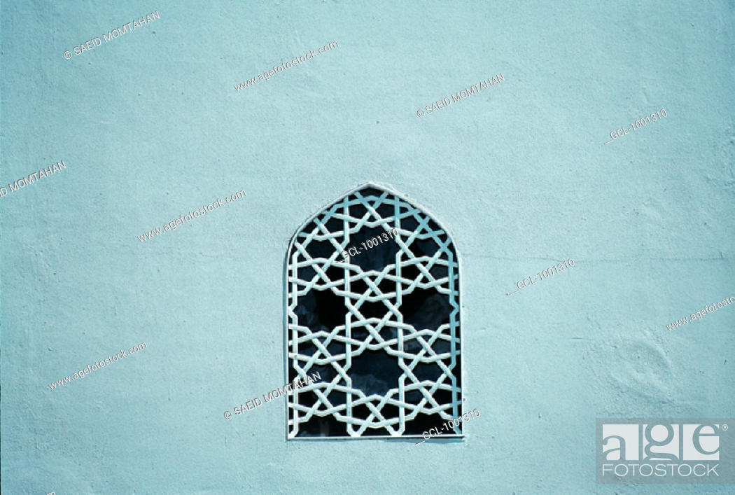 Stock Photo: Window decorated with arabesques.