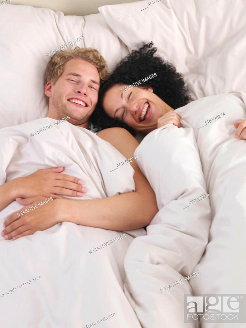 Stock Photo: young couple in bed.