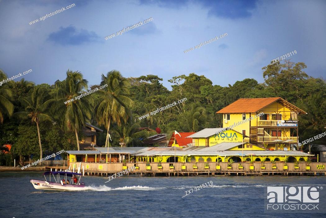 Stock Photo: Panama Bocas del Toro iconic view of boats and archipelago. Aqua Lounge Hostel and Bar Isla Carenero. Bocas del Toro is the capital of the Panamanian province.