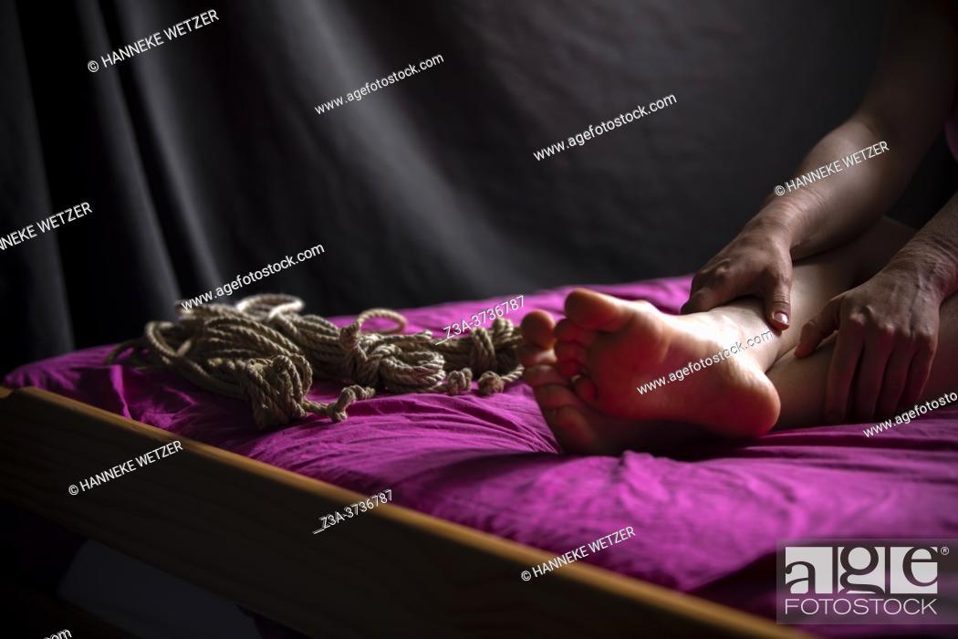 Stock Photo: Closeup of bondage on a woman.