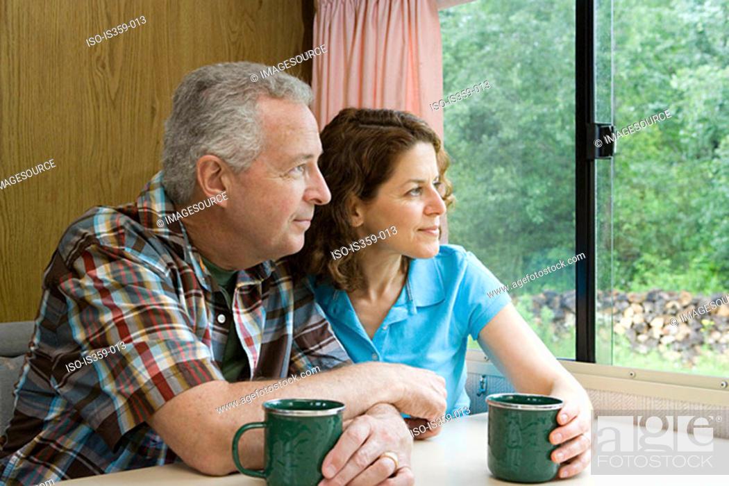 Stock Photo: Couple relaxing in caravan.