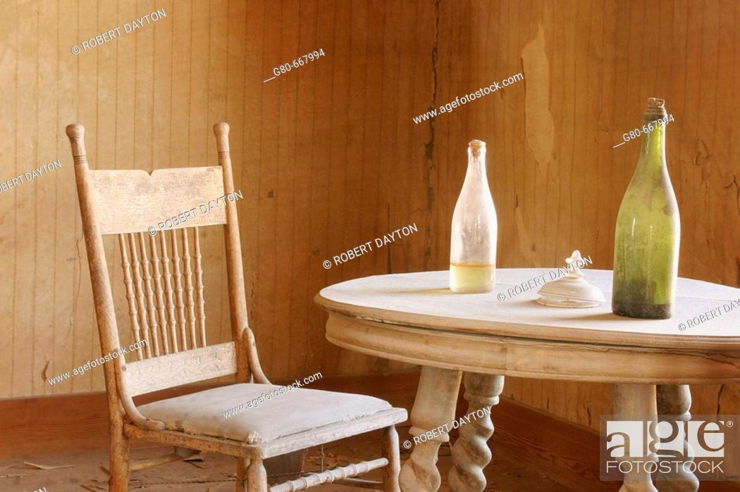 Stock Photo: Bottles on dining room table in Bodie residence, California, USA.