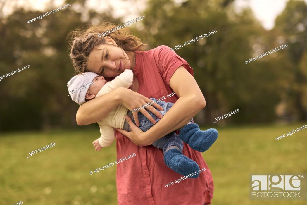 Stock Photo: mother, baby, outdoors, in park, generations, at Neuhofener Berg, Munich, Germany.