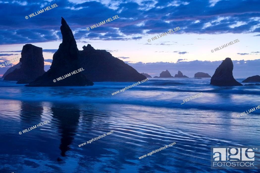Stock Photo: USA, Oregon, Coos County, Bandon State Park, sea stacks, surf, and beach at sunset, September.