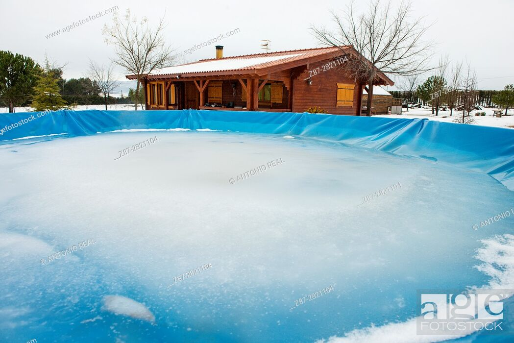 Stock Photo: Frozen pool and wooden house in winter. Almansa. Albacete province. Spain.