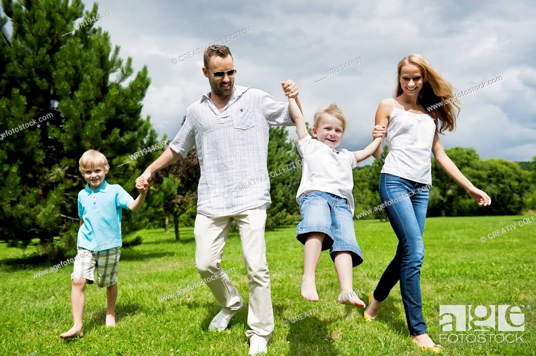 Stock Photo: Man, People, Summer, Human, Woman, Happy, Couple, Nature, Affection, Fondness, Love, Park, Child, Kid, Girl, Family, Father, Mother, Parent, Son, Trust, Brother, Sister, Daughter, Devotion, Marriage, Spring, Meadow, Luck, Married