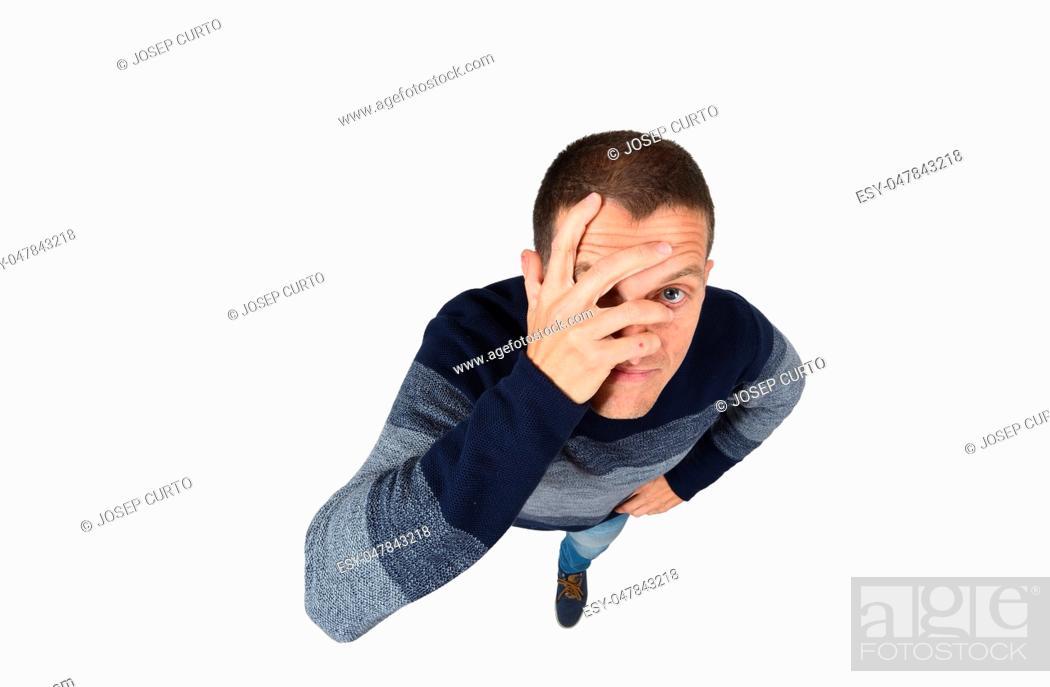 Stock Photo: man peeking with hand on face on white background.