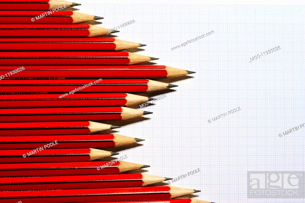 Stock Photo: Pencils forming bar graph pattern on graph paper view from above.