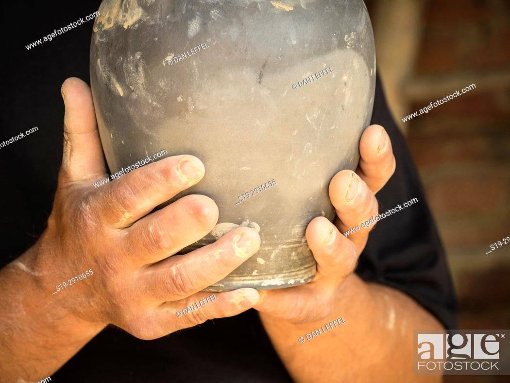 Stock Photo: Close up of potter's hands. Slovenia.