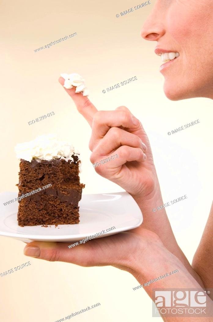 Stock Photo: A woman holding a chocolate cake.