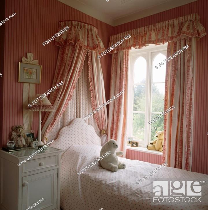 Bed With Coronet And Drapes Beside Window In Child S Bedroom With Pink Striped Wallpaper And Pink Stock Photo Picture And Rights Managed Image Pic Foh U19250055 Agefotostock