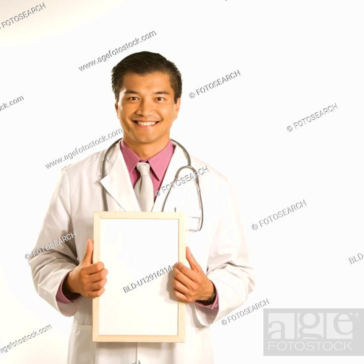 Stock Photo: Doctor holding blank sign.