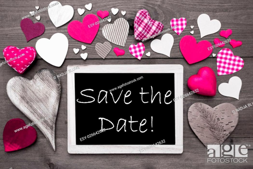 Stock Photo: Chalkboard With English Text Save The Date. Many Pink Textile Hearts. Grey Wooden Background With Vintage, Rustic Or Retro Style.