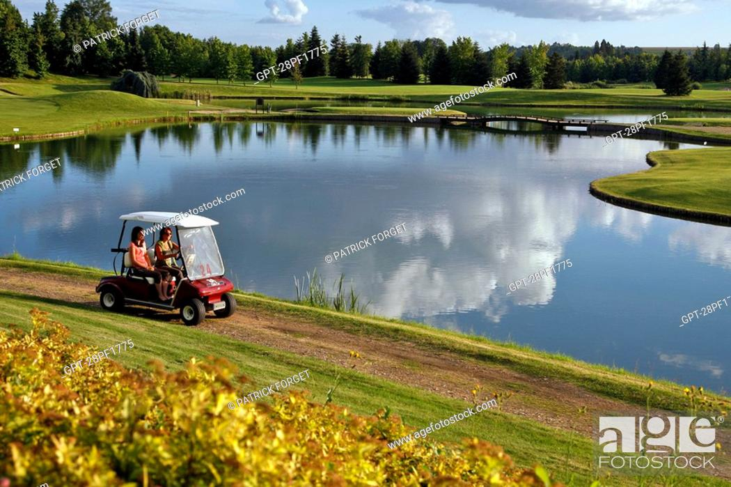 Imagen: THE NANTILLY GOLF COURSE STRETCHES OUT AROUND PONDS DOMINATED BY TREE-COVERED HILLS, EURE-ET-LOIR 28, FRANCE.
