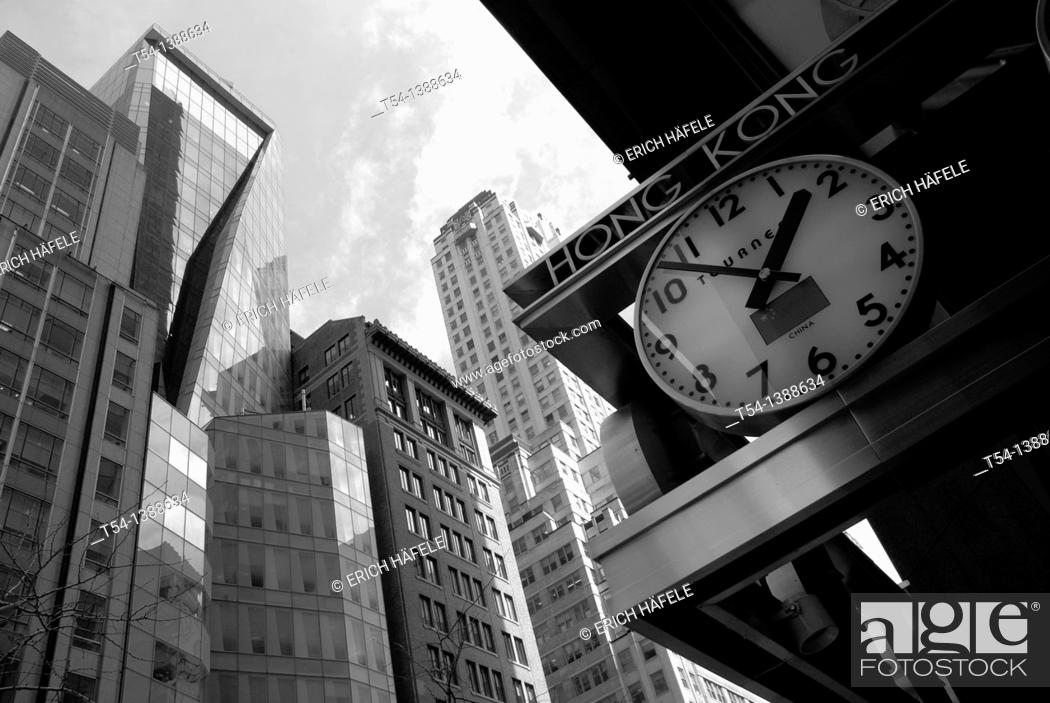 Stock Photo: Clock with Hong Kong Time in New York.