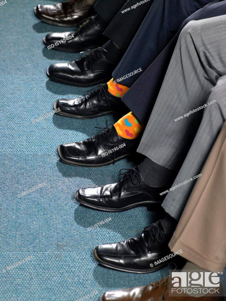Stock Photo: Businessman sitting in a row.