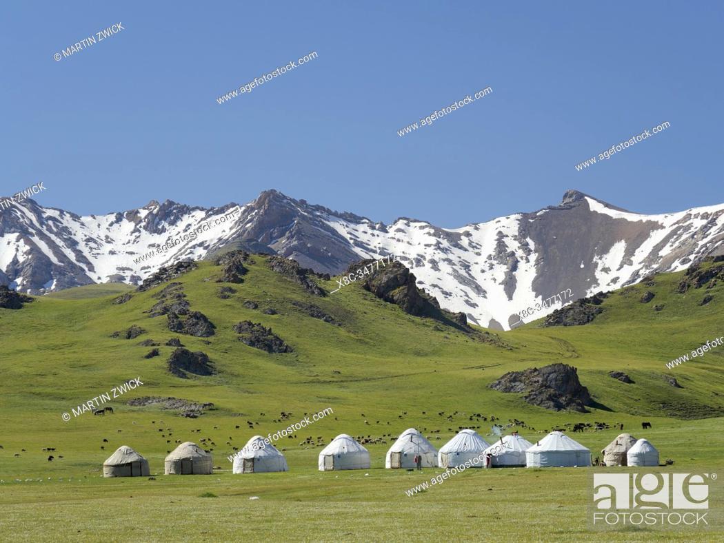 Stock Photo: Yurts for tourists at lake Song Kol (Son Kul, Songkoel, Song-Koel). Tien Shan mountains or heavenly mountains in Kirghizia.