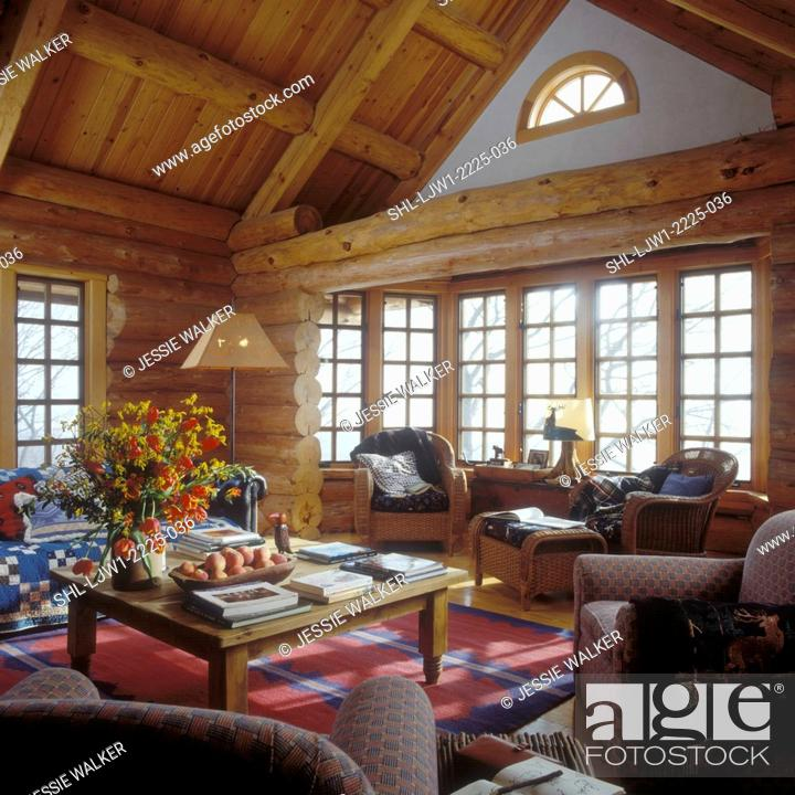 Stock Photo Living Room Log House Native American Rugs Wicker Furniture Pine Tables Natural Chairs Quilt Large Fl Arrangement Of