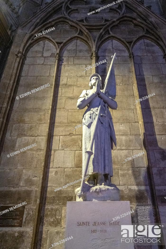 Stock Photo: 19th-century statute of Joan of Arc by Charles Desvergnes inside Notre-Dame de Paris, medieval gothic cathedral in Paris, France.