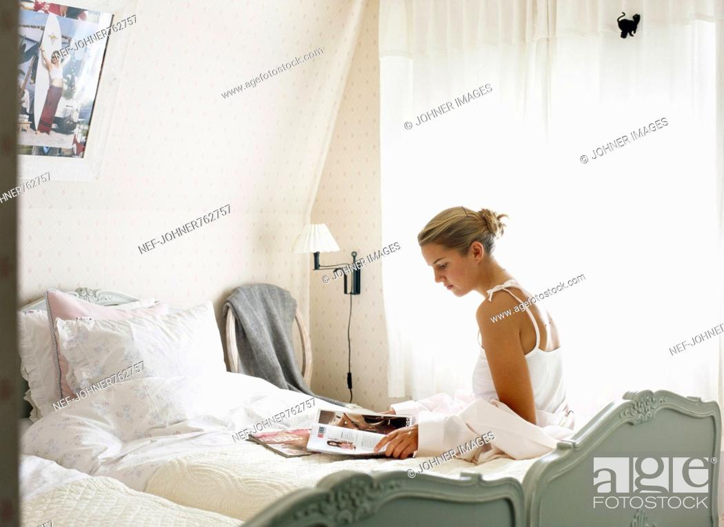 Stock Photo: A young woman i a bedroom.