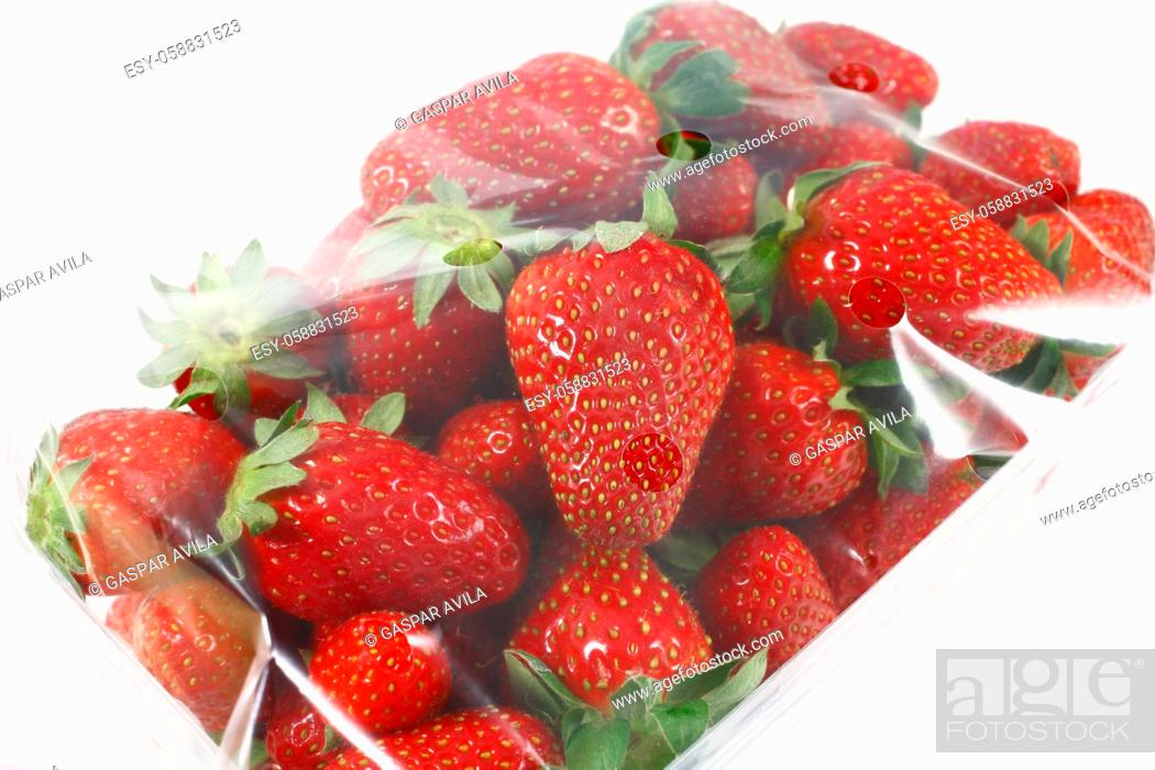 Stock Photo: Strawberries in a package, with plastic cover.