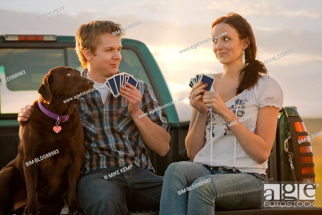Stock Photo: Caucasian couple playing cards in truck.