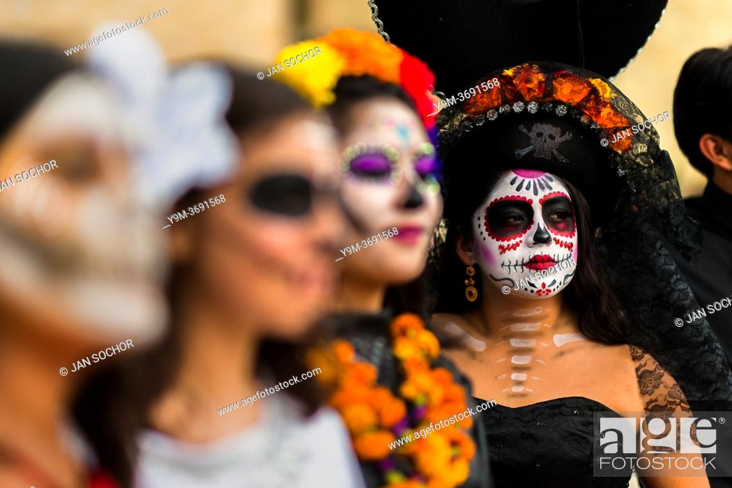Stock Photo: Young Mexican women, dressed as La Catrina, a Mexican pop culture icon representing the Death, take part in the Day of the Dead celebrations in Oaxaca, Mexico.