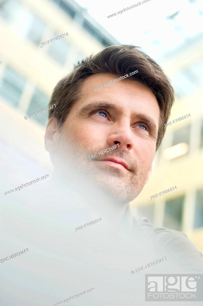 Stock Photo: Low angle view of a man.