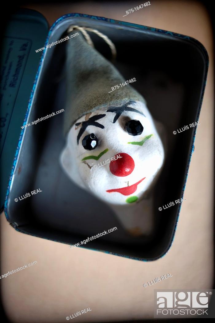 Stock Photo: ClownÂ's head in a box.