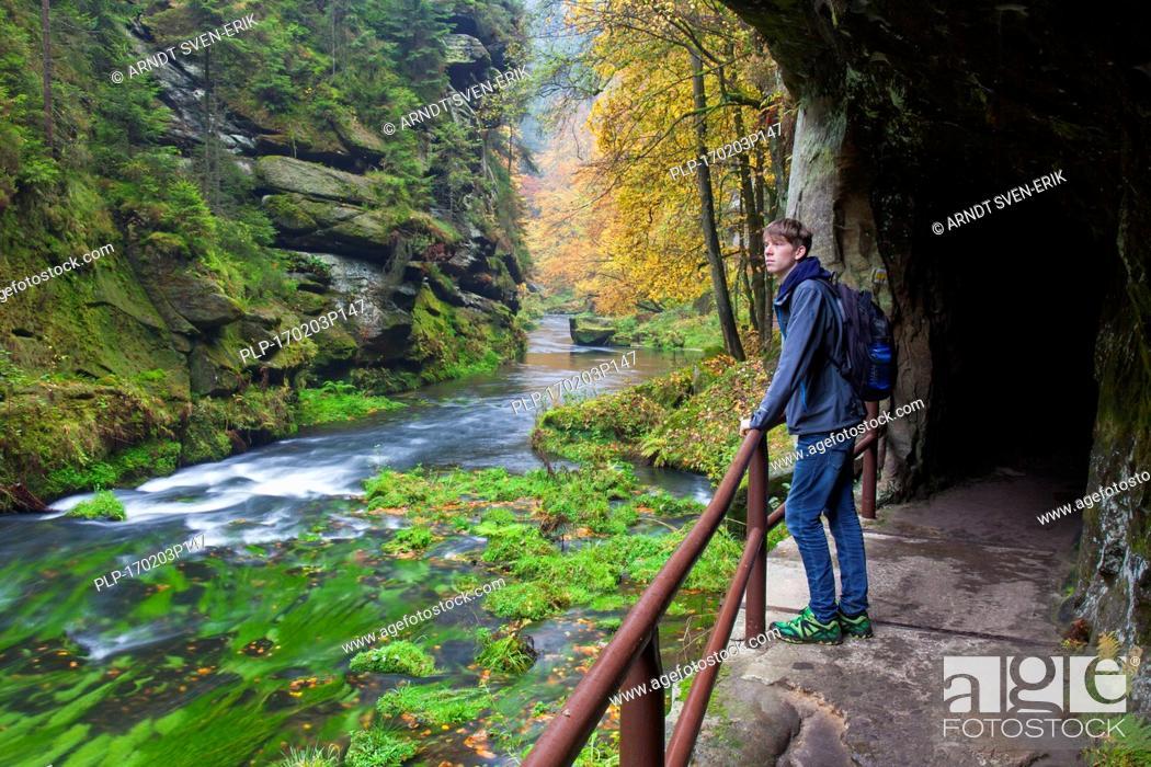 Stock Photo: Tourist visiting the Kamnitz Gorge / Soutesky Kamenice in Bohemian Switzerland in autumn, Ústí nad Labem Region / Ústecký Region, Czech Republic.