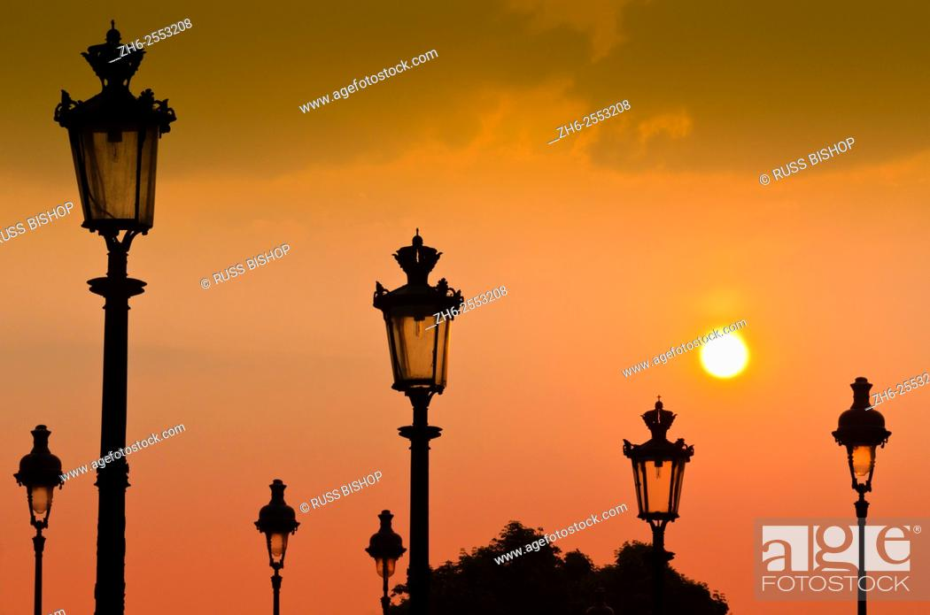 Stock Photo: Lamp posts at sunset, Louvre Museum, Paris, France.