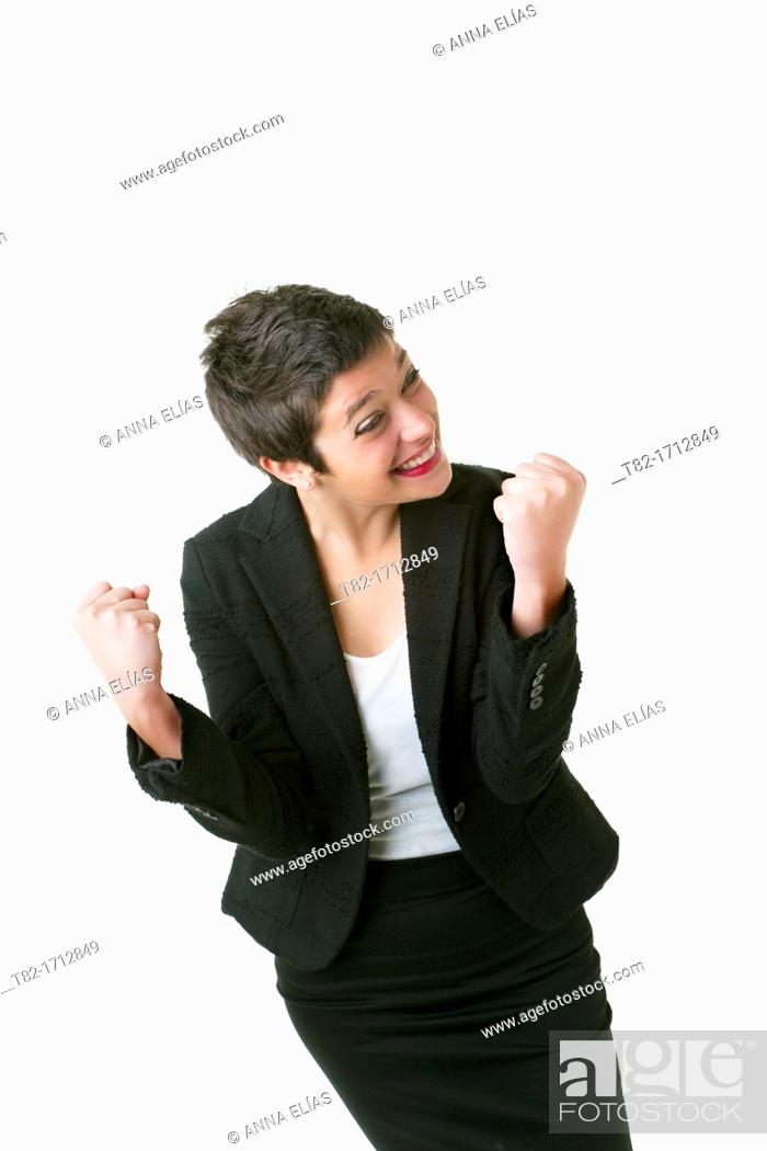 Stock Photo: smiling young woman with a look of success on white background.
