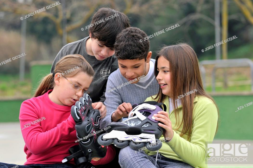 Stock Photo: Group of children with skates. Spain.