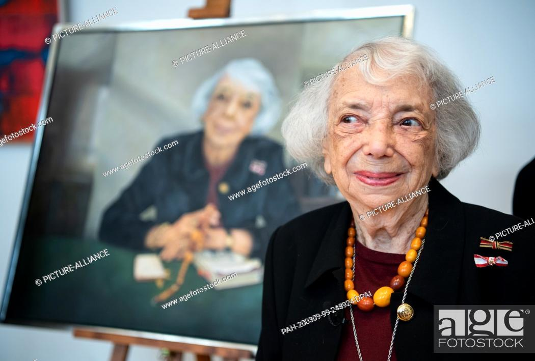 Stock Photo: 09 March 2020, Berlin: Margot Friedländer is standing in front of her portrait of honorary citizen at the ceremonial unveiling in the Berlin House of.
