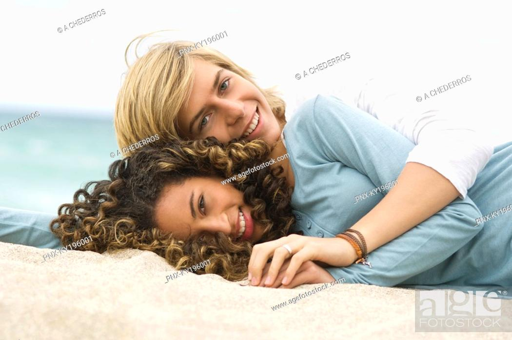 Stock Photo: Teenage boy and a girl relaxing on the beach.