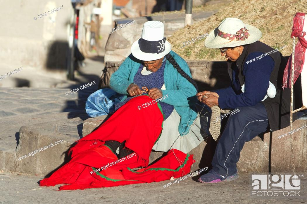 Stock Photo: Indigenous women in traditional clothing sewing at the side of the street in the historic center, Cusco, Peru, South America.