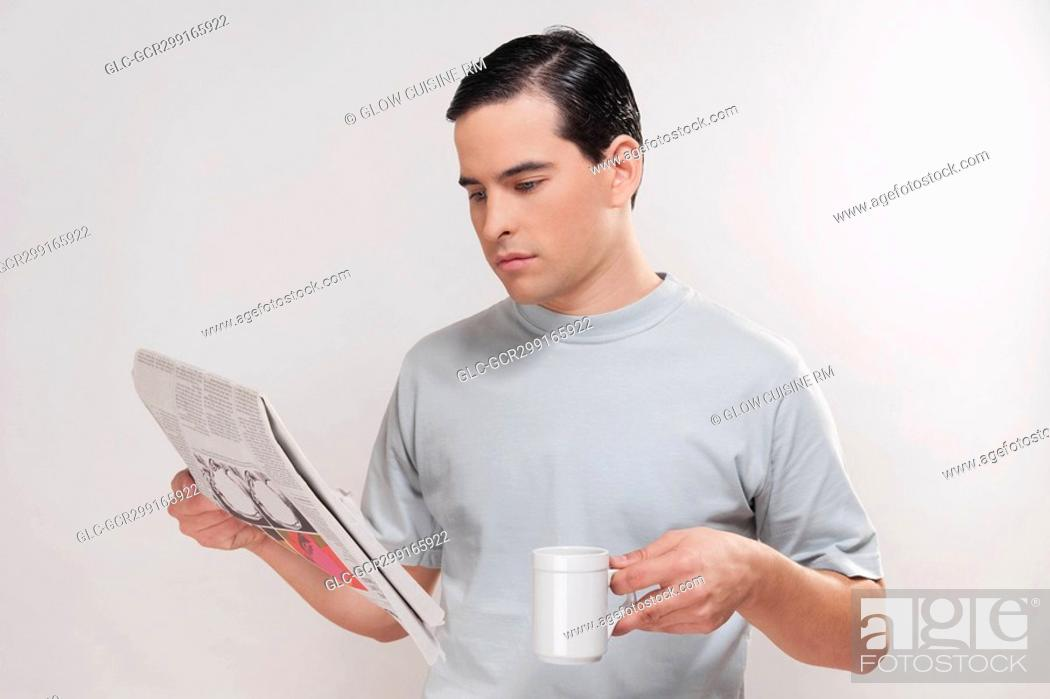 Stock Photo: Close-up of a man reading a newspaper.